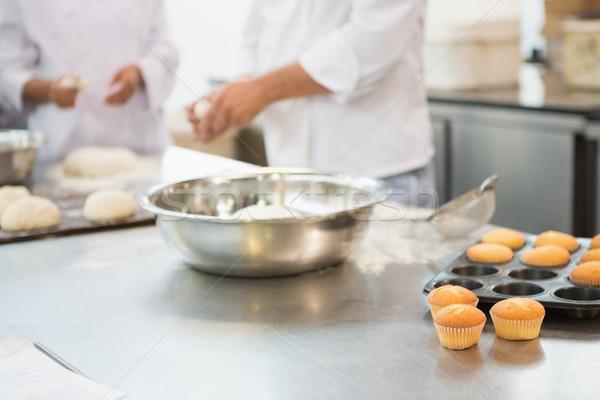 Colleagues making cupcakes on worktop Stock photo © wavebreak_media