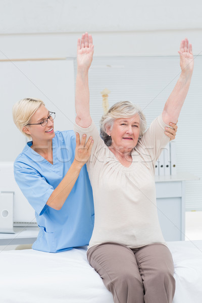 Nurse assisting female patient in exercising Stock photo © wavebreak_media