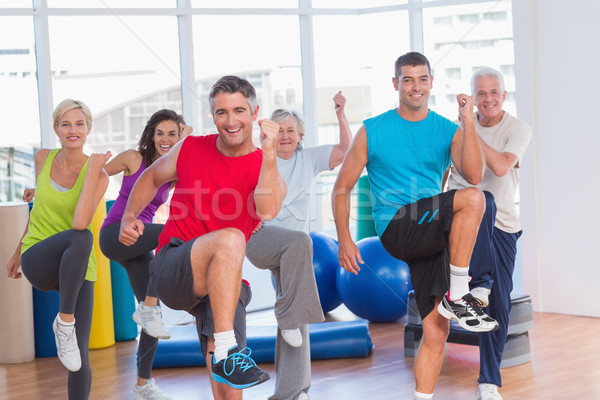 People performing aerobics exercise in gym class Stock photo © wavebreak_media