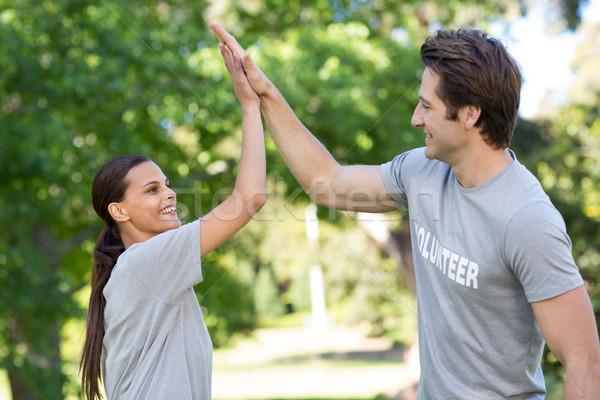 Mutlu gönüllü çift yüksek adam Stok fotoğraf © wavebreak_media