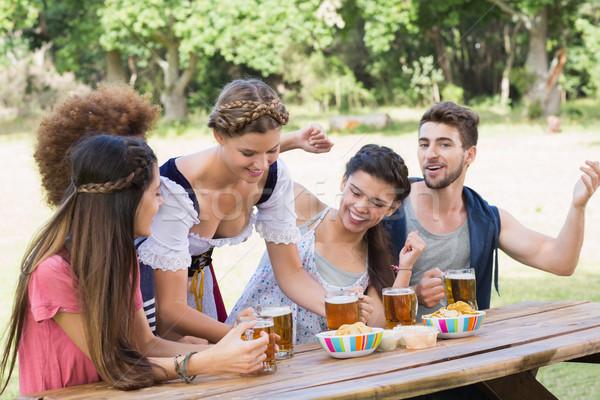 Csinos Oktoberfest lány adag barátok napos idő Stock fotó © wavebreak_media
