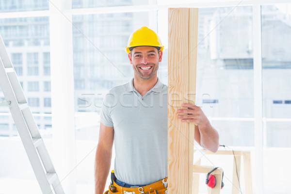 Sorridere maschio falegname costruzione Foto d'archivio © wavebreak_media