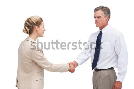 Sonriendo mujeres apretón de manos blanco mujer gente de negocios Foto stock © wavebreak_media