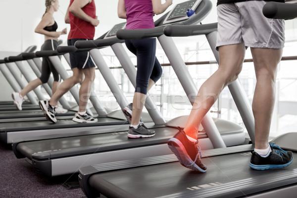 Highlighted ankle of man on treadmill Stock photo © wavebreak_media