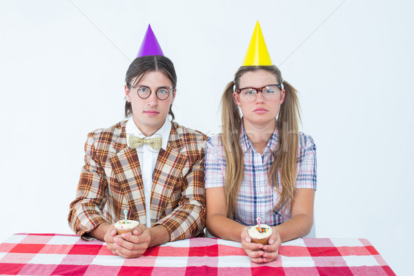 Unsmiling geeky hipsters celebrating birthday  Stock photo © wavebreak_media