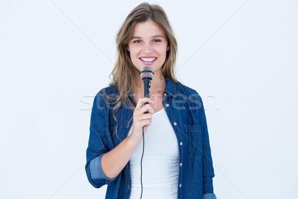 женщину пения микрофона белый красоту женщины Сток-фото © wavebreak_media