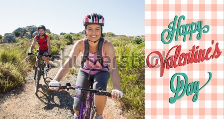 Composite image of active couple on a bike ride in the countryside  Stock photo © wavebreak_media