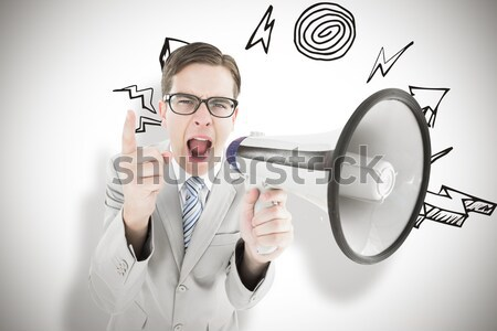 Composite image of geeky businessman shouting through megaphone Stock photo © wavebreak_media