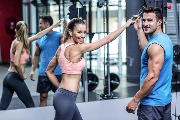 Muskularny kobieta trener człowiek szczęśliwy Zdjęcia stock © wavebreak_media