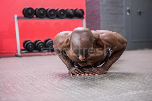 Young bodybuilder doing excercises Stock photo © wavebreak_media