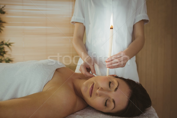 Young woman getting an ear candling treatment Stock photo © wavebreak_media