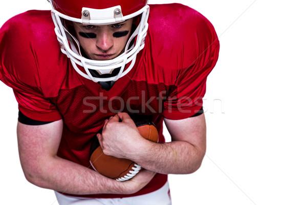 Americano futbolista ejecutando pelota blanco deporte Foto stock © wavebreak_media
