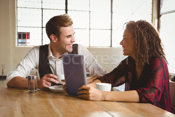 Cute couple on a date watching photos on a tablet Stock photo © wavebreak_media