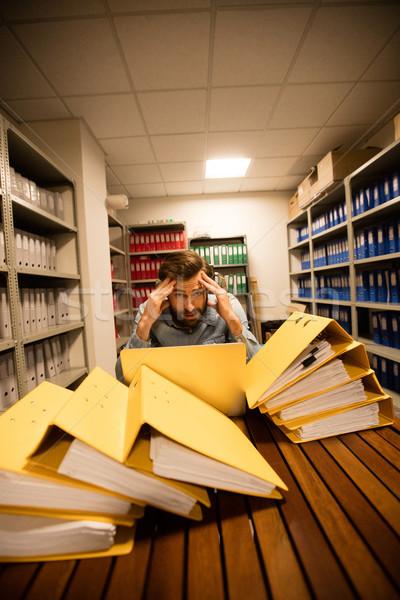 бизнесмен используя ноутбук файла портрет Сток-фото © wavebreak_media