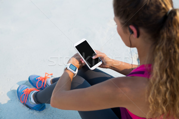 High angle view of woman using mobile phone at beach Stock photo © wavebreak_media