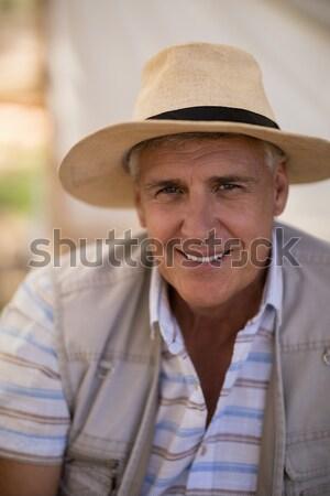 Sorridere uomo piedi braccia incrociate foresta Foto d'archivio © wavebreak_media