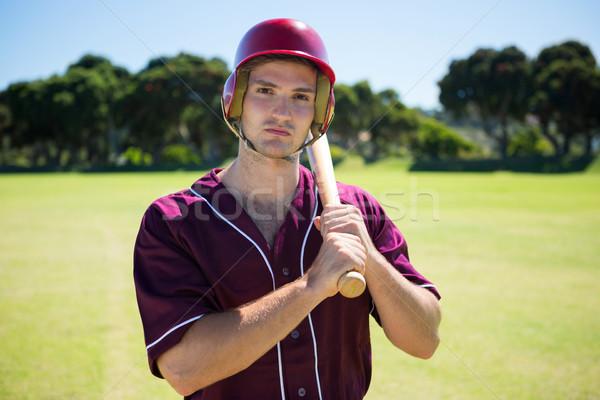 Portrait of young baseball player holding bat Stock photo © wavebreak_media