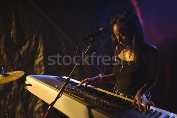 Musician playing piano in illuminated nightclub Stock photo © wavebreak_media