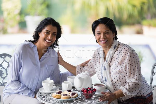 Portrait of woman having breakfast with mother Stock photo © wavebreak_media