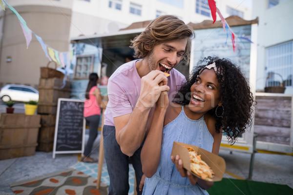 Happy woman feeding snacks to man Stock photo © wavebreak_media