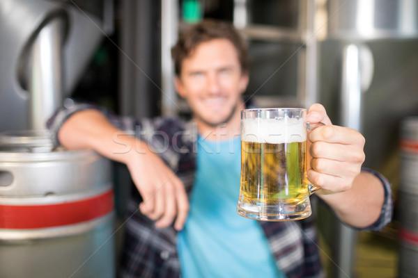 Close up of beer glass being held by worker Stock photo © wavebreak_media