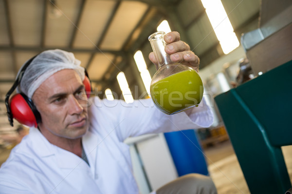 Technician examining olive oil produced from machine Stock photo © wavebreak_media