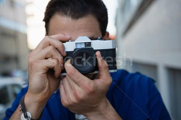 Man photographing with camera Stock photo © wavebreak_media