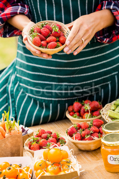 Midsection of woman selling strawberries Stock photo © wavebreak_media