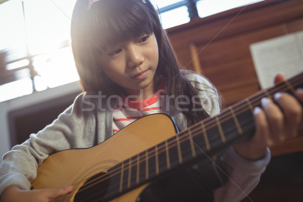 Concentrated girl practicing guitar Stock photo © wavebreak_media
