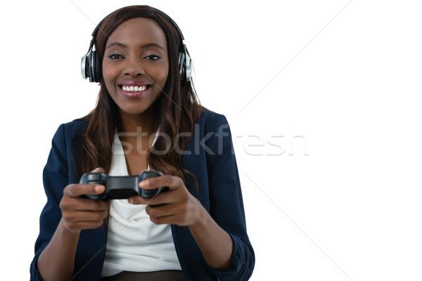 Alegre mujer de negocios jugando videojuegos blanco mujer Foto stock © wavebreak_media