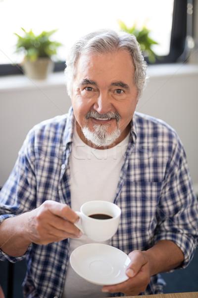 портрет улыбаясь старший человека чашку кофе Сток-фото © wavebreak_media