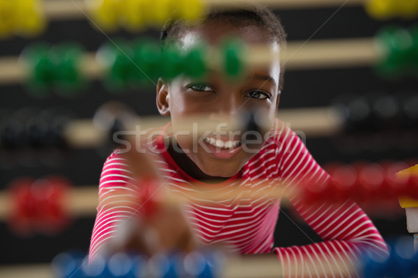Stock photo: Cute little girl counting on abacus
