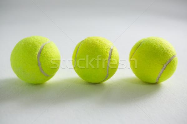 High angle view of fluorescent tennis balls Stock photo © wavebreak_media