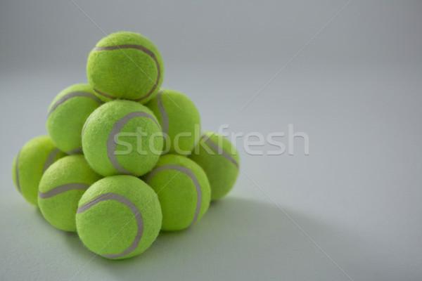 Halom fluoreszkáló tenisz golyók fehér üzlet Stock fotó © wavebreak_media
