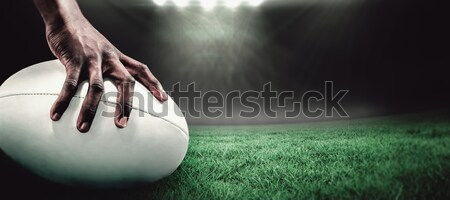 Cropped hand of sportsperson on rugby ball Stock photo © wavebreak_media