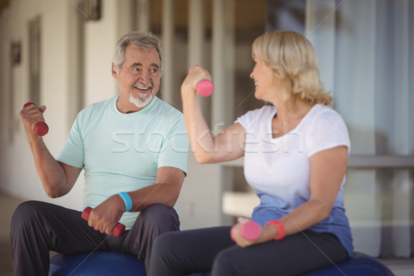 Senior couple sitting on fitness balls with dumbbells Stock photo © wavebreak_media