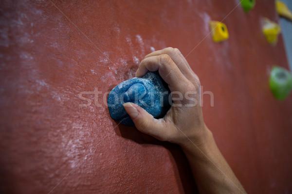 Athlete practicing rock climbing in fitness studio Stock photo © wavebreak_media