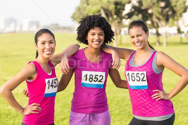 Három mosolyog futók mellrák maraton portré Stock fotó © wavebreak_media