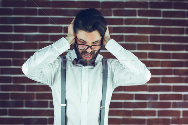 Portrait frustré homme oreilles mur de briques mode de vie Photo stock © wavebreak_media