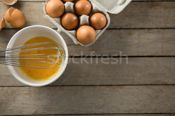 Overhead view of eggs in bowl and carton Stock photo © wavebreak_media