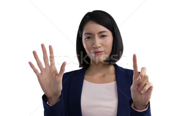 Businesswoman using invisible screen Stock photo © wavebreak_media
