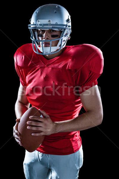 Portrait of determined sportsman with American football Stock photo © wavebreak_media