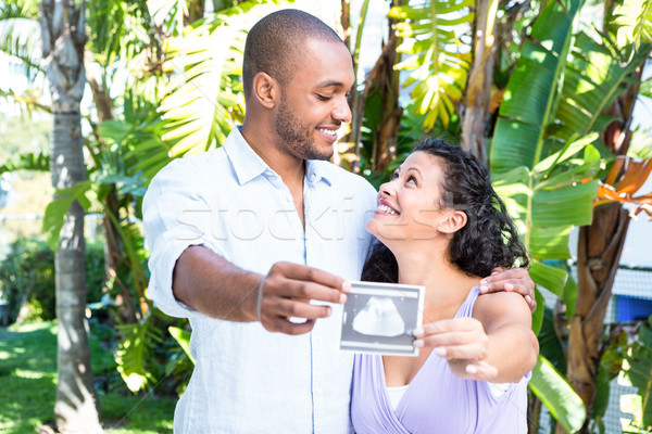 Happy husband with pregnant wife holding sonogram Stock photo © wavebreak_media