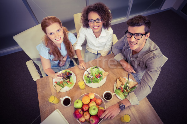 улыбаясь деловые люди поздний завтрак портрет Creative служба Сток-фото © wavebreak_media