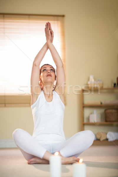 Woman in yoga pose with hands joined Stock photo © wavebreak_media
