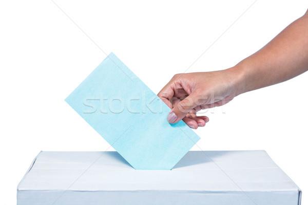 Businesswoman putting ballot in vote box Stock photo © wavebreak_media