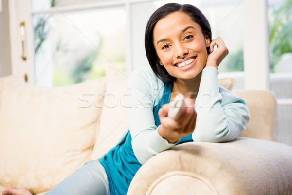 笑みを浮かべて ブルネット リモート ソファ 幸せ ホーム ストックフォト © wavebreak_media