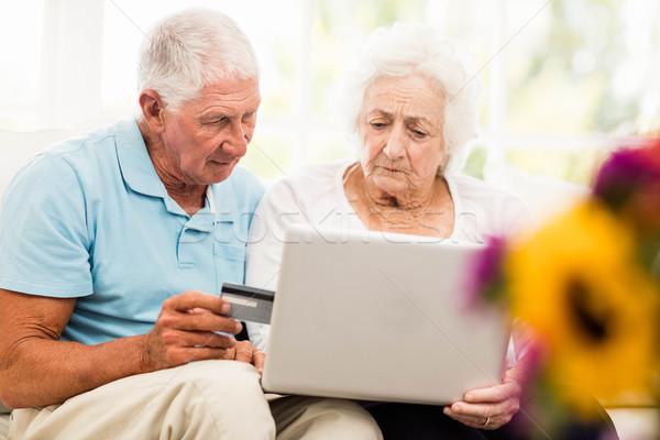 Focused senior couple using laptop Stock photo © wavebreak_media