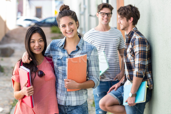 Hip friends holding notebooks Stock photo © wavebreak_media