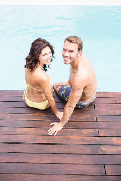 Young couple sitting by poolside Stock photo © wavebreak_media
